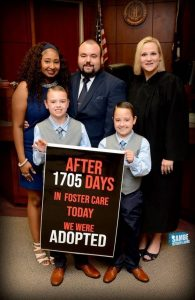 Foster parent family in court on adoption day