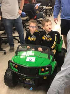twin boys in a John Deere tractor
